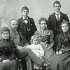 Thumbnail: Celia, William, Earnest, Edith, Gertrude, Wilfred, Sarah and Florence Brooks posing for family picture circa 1900.