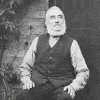 Thumbnail: George Ashness Ward outside his house.