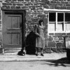 Thumbnail: Mary McGregor standing outside Number 1 South Street with her dog.
